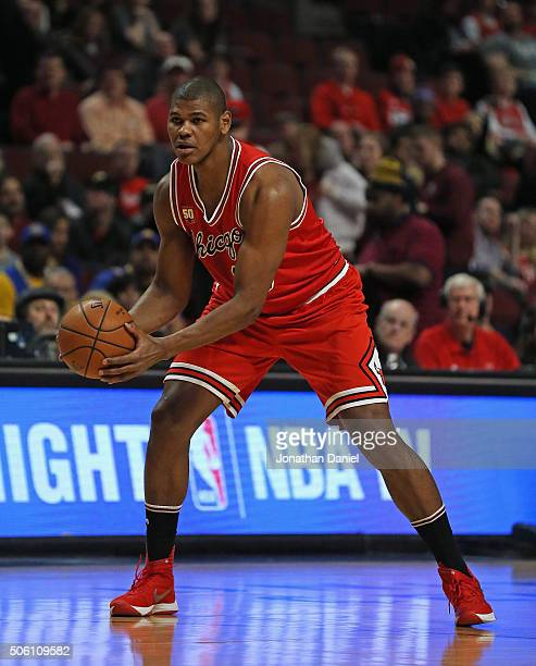 Cristiano Felicio of the Chicago Bulls looks to pass against the Golden State Warriors at the United Center on January 20 2016 in Chicago Illinois...
