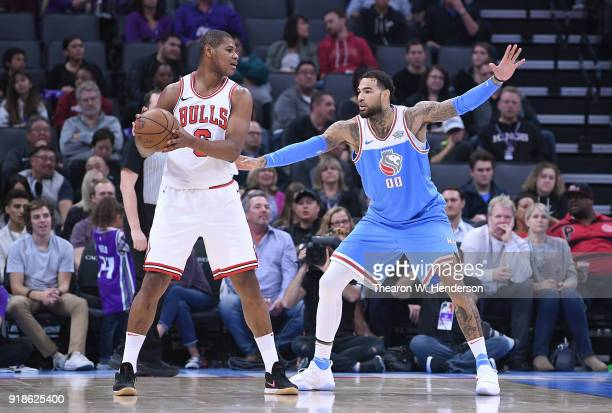 Cristiano Felicio of the Chicago Bulls looks to pass the ball while guarded by Willie CauleyStein of the Sacramento Kings during an NBA basketball...