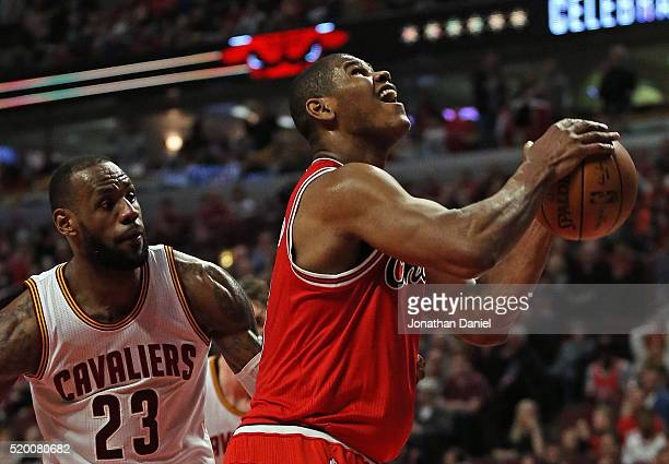 Cristiano Felicio of the Chicago Bulls puts up a shot past LeBron James of the Cleveland Cavaliers at the United Center on April 9 2016 in Chicago...