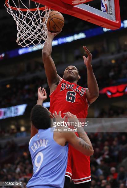 Cristiano Felicio of the Chicago Bulls shoots over Allen Crabbe of the Minnesota Timberwolves at the United Center on January 22, 2020 in Chicago,...