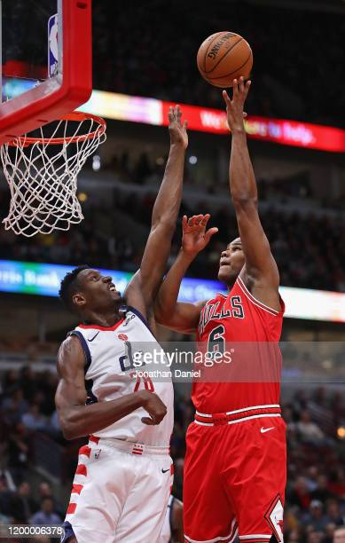 Cristiano Felicio of the Chicago Bulls shoots over Ian Mahinmi of the Washington Wizards at the United Center on January 15, 2020 in Chicago,...