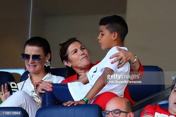 Cristiano Jr and Maria Dolores dos Santos Aveiro, son and mother of Cristiano Ronaldo of Portugal, chat during the UEFA Nations League Final between...
