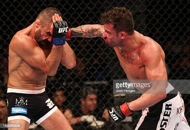 Cristiano Marcello punches Reza Madadi during their lightweight fight at UFC 153 inside HSBC Arena on October 13 2012 in Rio de Janeiro Brazil