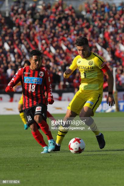 Cristiano of Kashiwa Reysol and Chanathip Songkrasin of Consadole Sappporo compete for the ball during the JLeague J1 match between Consadole Sapporo...