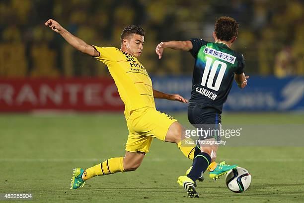 Cristiano of Kashiwa Reysol and Daisuke Kikuchi of Shonan Bellmare compete for the ball during the J.League match between Shonan Bellmare and Kashiwa...