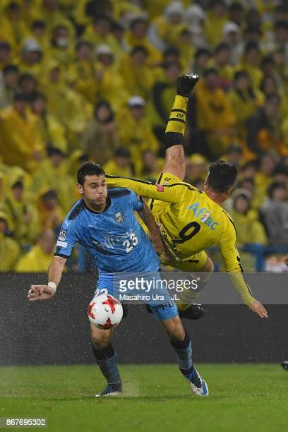 Cristiano of Kashiwa Reysol and Eduardo of Kawasaki Frontale compete for the ball during the JLeague J1 match between Kashiwa Reysol and Kawasaki...