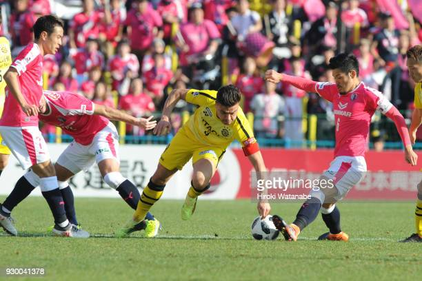 Cristiano of Kashiwa Reysol and Hotaru Yamaguchi of Cerezo Osaka compete for the ball during the JLeague J1 match between Kashiwa Reysol and Cerezo...