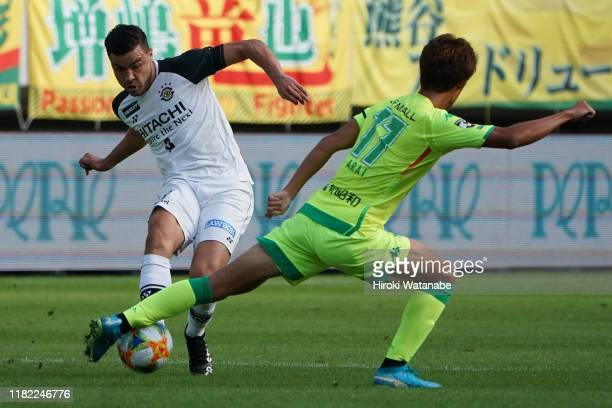 Cristiano of Kashiwa Reysol and Ikki Arai of JEF United Chiba compete for the ball during the J.League J2 match between JEF United Chiba and Kashiwa...