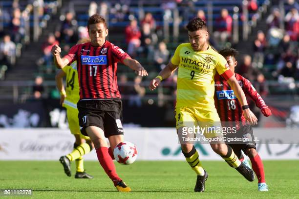 Cristiano of Kashiwa Reysol and Junichi Inamoto of Consadole Sapporo compete for the ball during the JLeague J1 match between Consadole Sapporo and...