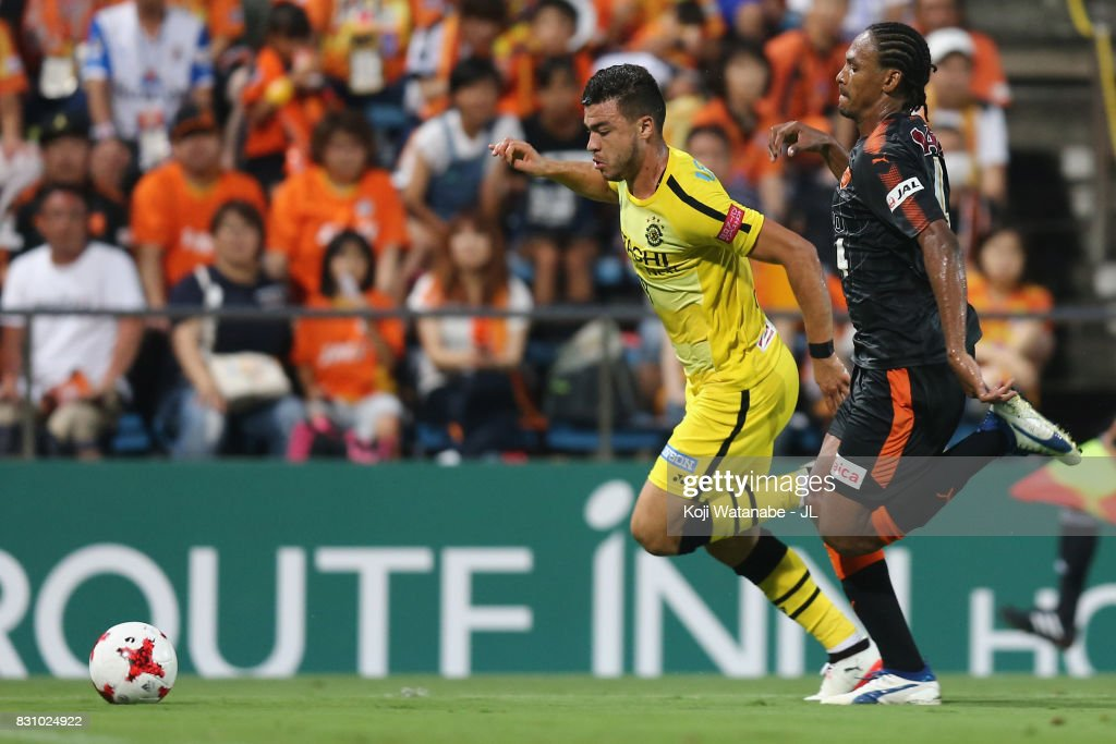 Cristiano of Kashiwa Reysol and Kanu of Shimizu S-Pulse compete for the ball during the J.League J1 match between Shimizu S-Pulse and Kashiwa Reysol at IAI Stadium Nihondaira on August 13, 2017 in Shizuoka, Japan.