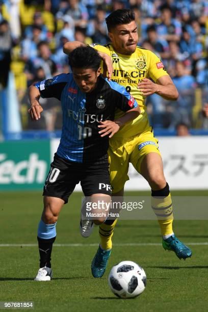 Cristiano of Kashiwa Reysol and Ryota Oshima of Kawasaki Frontale compete for the ball during the JLeague J1 match between Kashiwa Reysol and...