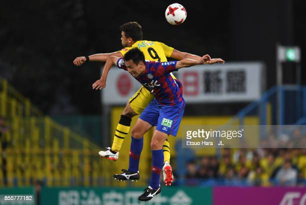 Cristiano of Kashiwa Reysol and Toshio Shimakawa of Ventforet Kofu compete for the ball during the J.League J1 match between Kashiwa Reysol and...