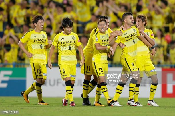Cristiano of Kashiwa Reysol celebrates scoring his side's second goal with his team mates during the JLeague J1 match between Kashiwa Reysol and...