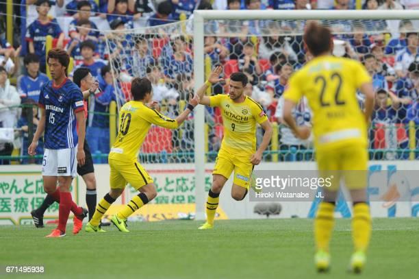 Cristiano of Kashiwa Reysol celebrates scoring the opening goal with his team mate Yuki Otsu during the JLeague J1 match between Kashiwa Reysol and...