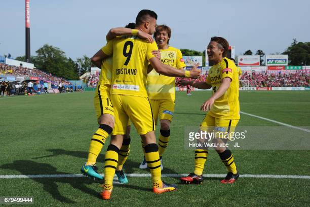 Cristiano of Kashiwa Reysol celebrates scoring the opening goal with his team mates during the JLeague J1 match between Kashiwa Reysol and Cerezo...