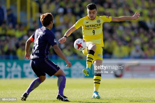 Cristiano of Kashiwa Reysol controls the ball under pressure of Toshihiro Aoyama of Sanfrecce Hiroshima during the JLeague J1 match between Kashiwa...