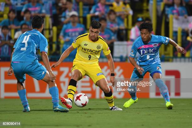 Cristiano of Kashiwa Reysol controls the ball under pressure of Riki Harakawa and Masato Fujita of Sagan Tosu during the JLeague J1 match between...