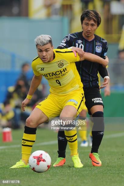 Cristiano of Kashiwa Reysol controls the ball under pressure of Shu Kurata of Gamba Osaka during the JLeague J1 match between Kashiwa Reysol and...