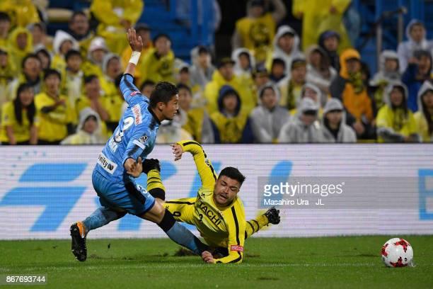 Cristiano of Kashiwa Reysol is tackled by Tatsuki Nara of Kawasaki Frontale during the J.League J1 match between Kashiwa Reysol and Kawasaki Frontale...