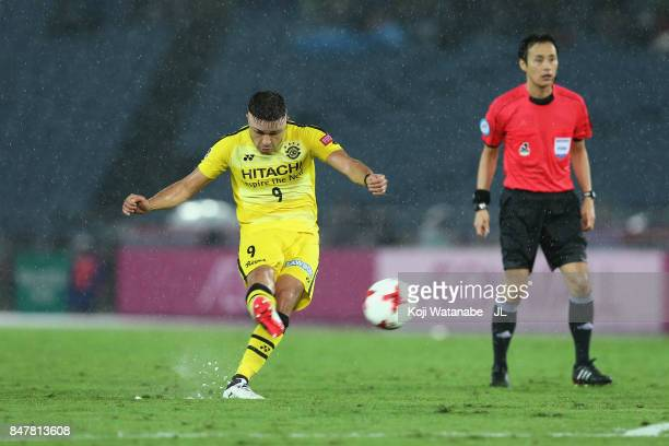 Cristiano of Kashiwa Reysol scores his side's first goal from a free kick during the JLeague J1 match between Yokohama FMarinos and Kashiwa Reysol at...