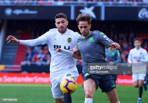 Cristiano Piccini defender of Valencia CF competes for the ball with Adnan Januzaj midfielder of Real Sociedad during the La Liga match between...