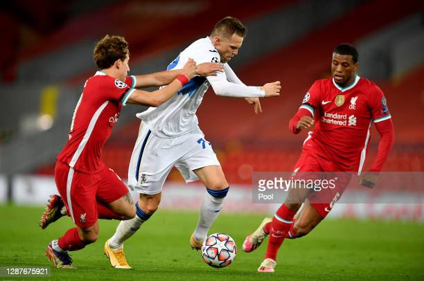 Cristiano Piccini of Atalanta B.C. Is challenged by Sepp van den Berg and Georginio Wijnaldum of Liverpool during the UEFA Champions League Group D...