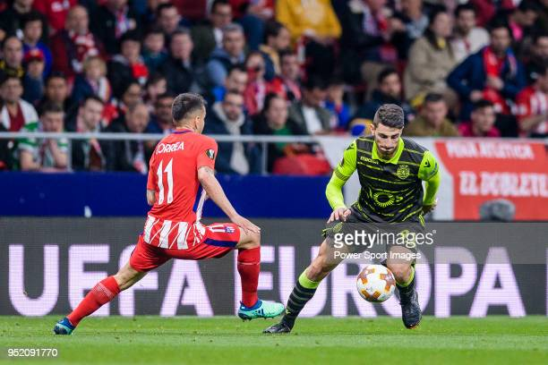 Cristiano Piccini of Sporting CP fights for the ball with Angel Correa of Atletico de Madrid during the UEFA Europa League quarter final leg one...