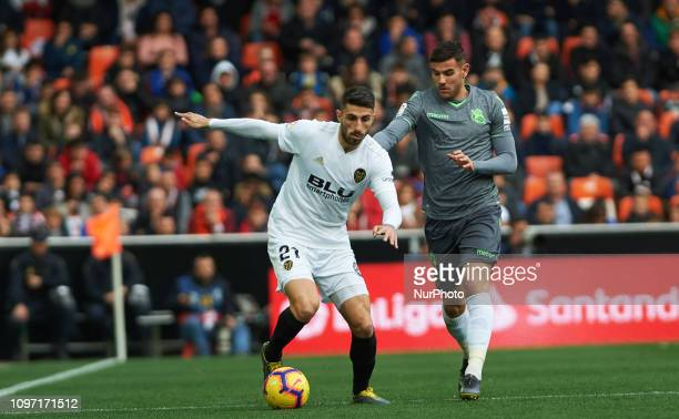 Cristiano Piccini of Valencia CF and Theo Hernandez of Real Sociedad during the La Liga match between Valencia and Real Sociedad at Estadio de...