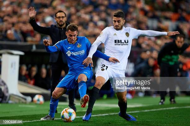 Cristiano Piccini of Valencia CF competes for the ball with Sebastian Cristoforo of Getafe CF during the Copa del Rey Quarter Final match between...