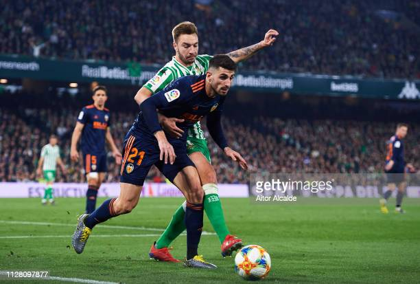 Cristiano Piccini of Valencia CF duels for the ball with Loren Moron of Real Betis during the Copa del Semi Final first leg match between Real Betis...