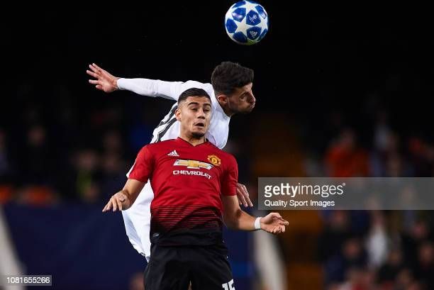 Cristiano Piccini of Valencia competes for the ball with Andreas Pereira of Manchester United during the UEFA Champions League Group H match between...