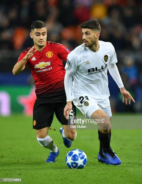 Cristiano Piccini of Valencia holds of Andreas Pereira of Manchester United during the UEFA Champions League Group H match between Valencia and...
