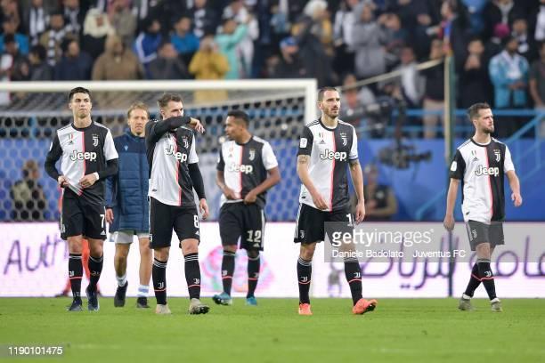 Cristiano Ronaldo Aaron Ramsey Leonardo Bonucci and Miralem Pjanic of Juventus after the Italian Supercup match between Juventus and SS Lazio at King...