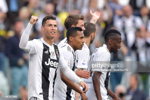 Cristiano Ronaldo, Alex Sandro, Daniele Rugani and Blaise Matuidi of Juventus celebrate after 2-1 scored by an own goal of Germán Pezzella of AFC...