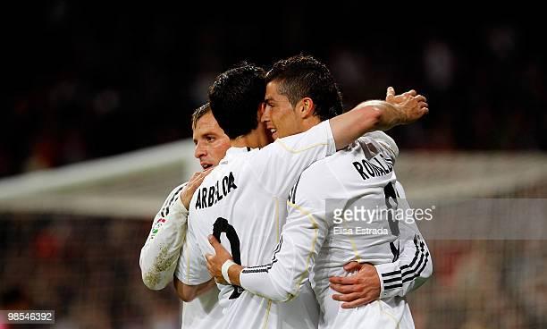 Cristiano Ronaldo , Alvaro Arbeloa and Rafael Van der Vaart of Real Madrid celebrate the first goal of their team during the La Liga match between...