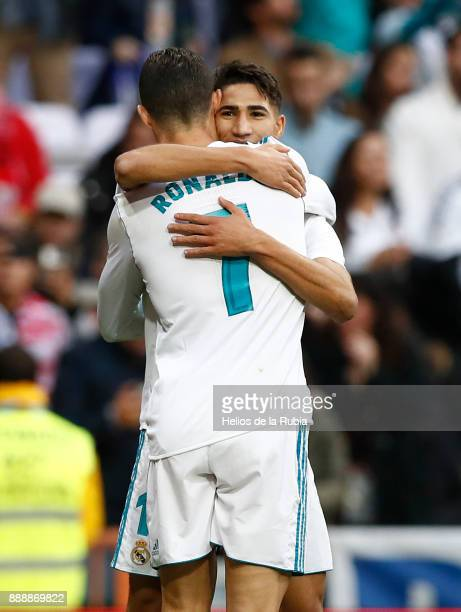 Cristiano Ronaldo and Achraf hakimi of Real Madrid celebrate after scoring during the La Liga match between Real Madrid and Sevilla at Estadio...