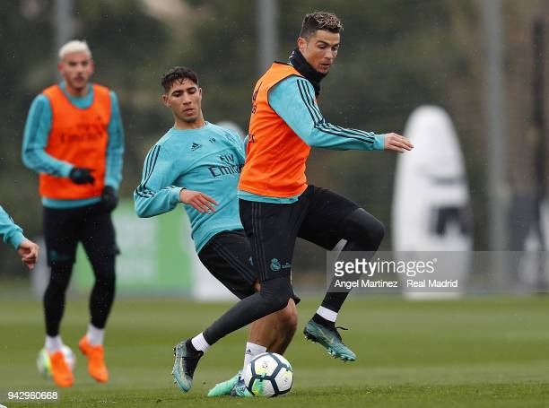 Cristiano Ronaldo and Achraf Hakimi of Real Madrid in action during a training session at Valdebebas training ground on April 7 2018 in Madrid Spain