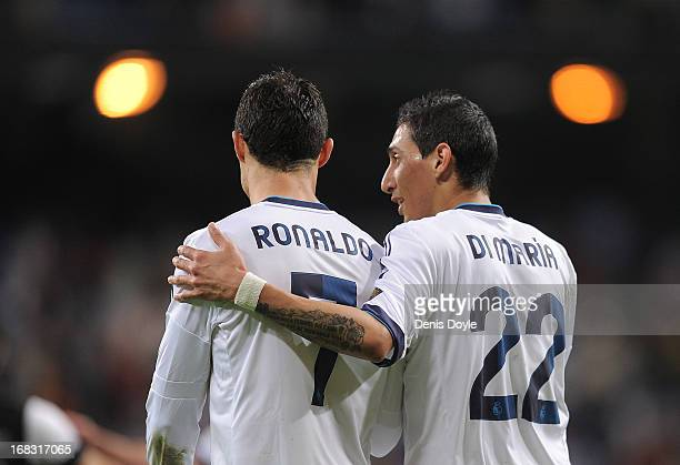 Cristiano Ronaldo and Angel di Maria of Real Madrid CF chat after the La Liga match between Real Madrid CF and Malaga CF at estadio Santiago Bernabeu...