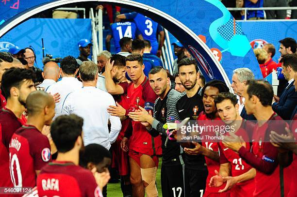 Cristiano Ronaldo and Anthony Lopes of Portugal during the European Championship Final between Portugal and France at Stade de France on July 10 2016...