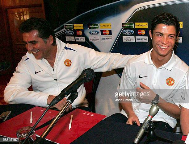 Cristiano Ronaldo and Carlos Queiroz of Manchester United laugh as they enter the press conference at which Queiroz acted as interpreter ahead of the...