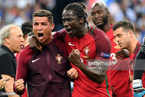 Cristiano Ronaldo and Eder of Portugal celebrates after Portugal's 10 win against France during the UEFA EURO 2016 Final match between Portugal and...