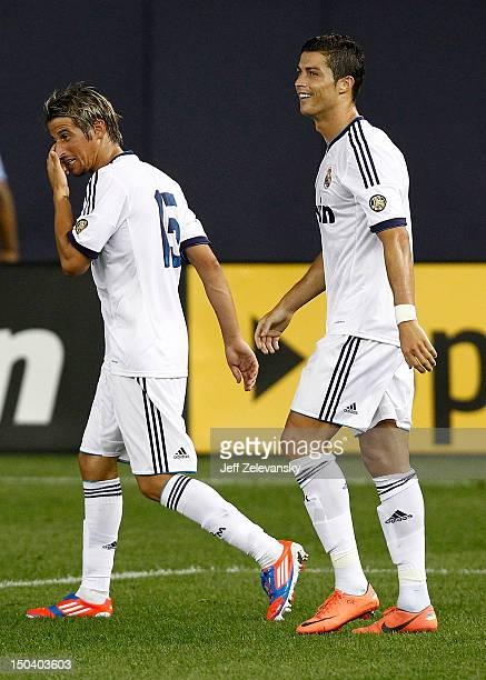 Cristiano Ronaldo and Fabio Coentrao of Real Madrid walk together after a goal against AC Milan during their match at Yankee Stadium on August 8 2012...