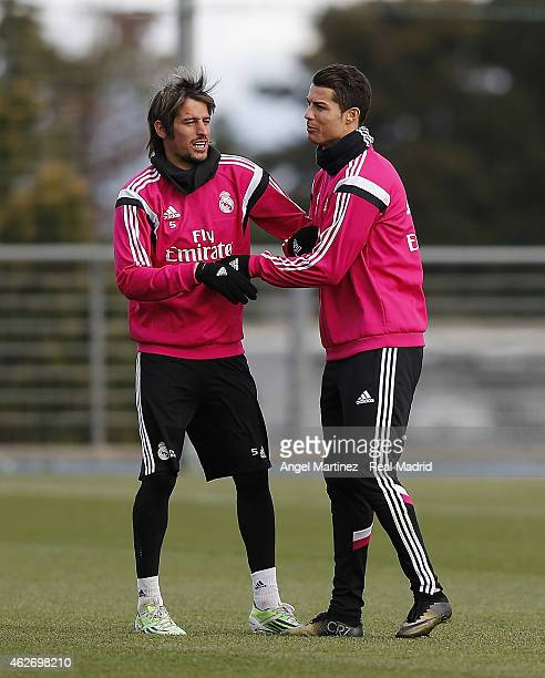Cristiano Ronaldo and Fabio Coentraoof Real Madrid joke during a training session at Valdebebas training ground on February 3 2015 in Madrid Spain