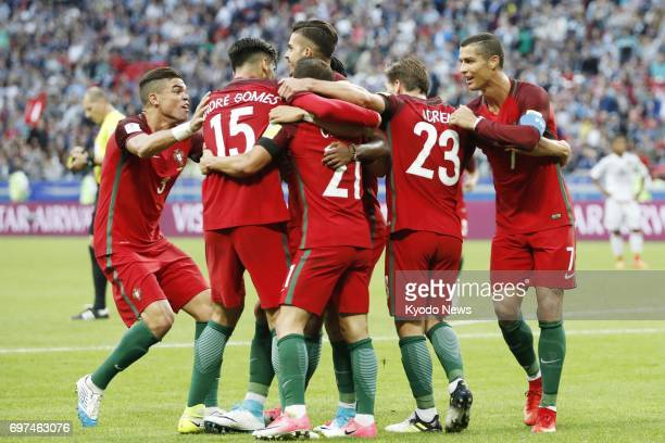 Cristiano Ronaldo and fellow players of the Portuguese national team celebrate after Cedric Soares scored the team's second goal during the second...