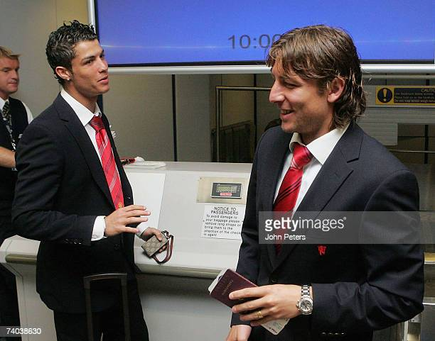 Cristiano Ronaldo and Gabriel Heinze of Manchester United check in at Manchester Airport ahead of their UEFA Champions League SemiFinal Second Leg...