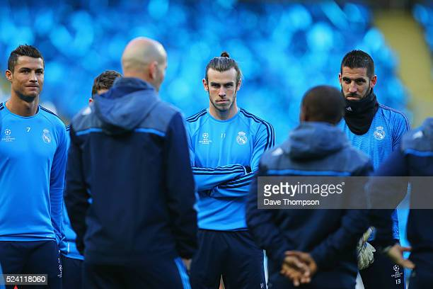 Cristiano Ronaldo and Gareth Bale listen to Zinedine Zidane manager of Real Madrid during a Real Madrid training session on the eve of their UEFA...