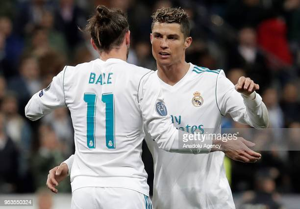 Cristiano Ronaldo and Gareth Bale of Real Madrid celebrate their victory at the end of the UEFA Champions League semi final second leg match between...