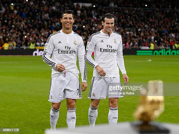 Cristiano Ronaldo and Gareth bale of Real Madrid CF Golden Boot award as best European scorer prior to start the La Liga match between Real Madrid CF...