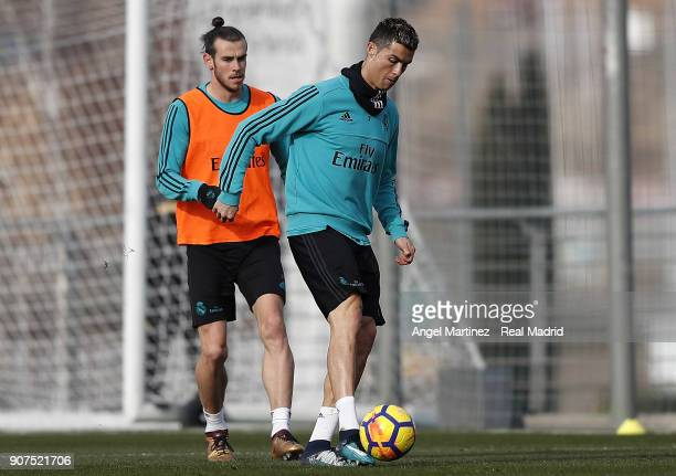 Cristiano Ronaldo and Gareth Bale of Real Madrid in action during a training session at Valdebebas training ground on January 20 2018 in Madrid Spain