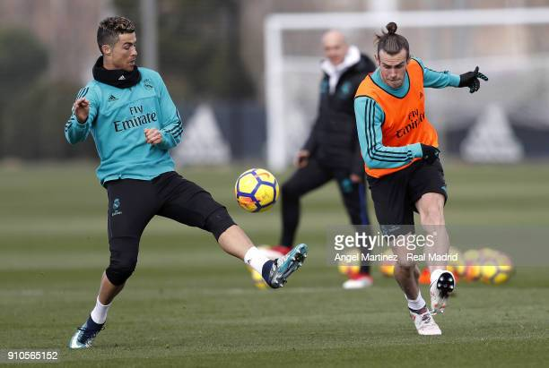 Cristiano Ronaldo and Gareth Bale of Real Madrid in action during a training session at Valdebebas training ground on January 26 2018 in Madrid Spain